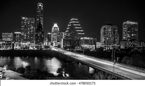 Austin Texas skyline cityscape at night black and white long exposure traffic over congress bridge
