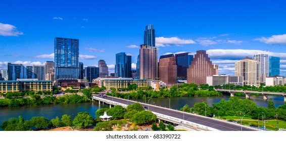 Austin Texas skyline during mid-day sunny summer perfect blue sky with entire city scape office buildings capital cities cityscape auditorium shores Panoramic
