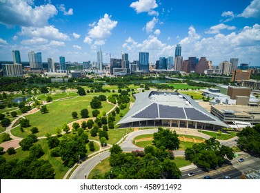Austin Texas Skyline in gorgeous colorful summer view with large solar panel array on top of building in foreground and the cityscape background aerial drone view