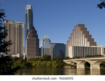 Austin, Texas skyline, Lady Bird Lake and Congress Avenue Bridge. This barrel-arched bridge with its open construction was built in 1910 and is an Austin landmark.