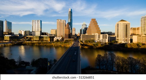 Austin Texas sunset over lady bird lake during clear sky summer evening as the sun sets and produces golden hour lighting across the skyline cityscape downtown