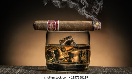 Austin, Texas,  United States - 08/16/2018 Cigar with a glass of whiskey