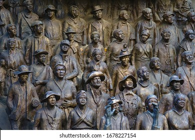 Austin, Texas / USA - December 29 2019: Detail of a crowd on the Emancipation Statue at the Texas Capitol - Texas African American History Memorial