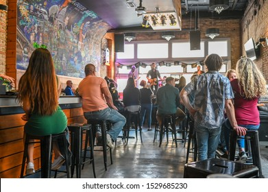 AUSTIN, TEXAS, USA - MARCH 17, 2019: Music bar on Sixth Street in Austin Texas during St Patricks day in March 2019. This historic street is famous for its live music bars.