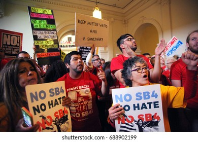 Austin, Texas, USA - May 29, 2017:  Demonstrators protest SB 4, an anti-Sanctuary Cities immigration law, under the dome of the state Capitol.