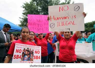 Austin, Texas, USA - May 29, 2017:  A Hispanic mother and her daughter protest SB 4, an anti-Sanctuary Cities immigration law, outside the Capitol.