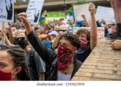Austin, Texas / USA - May 30, 2020: Protesters demonstrate against police brutality outside of the City of Austin Police Department headquarters in Downtown Austin, TX.