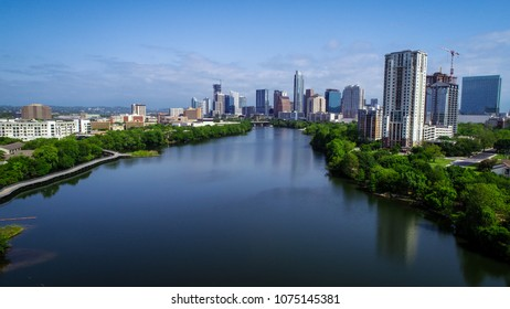 Austin , Texas , USA skyline cityscape downtown reflections of blue waters and spring time town lake - aerial view -
