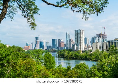 Austin , Texas , USA skyline cityscape downtown overlook at Travis Heights green landscape and Texas hill country hill top view overlooking the entire city skyline