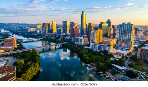 Austin Texas USA sunrise skyline cityscape over Town Lake or Lady Bird Lake with amazing reflection. Skyscrapers and Texas capital building in distance you can see the entire city during summer