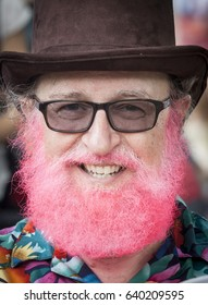 AUSTIN, TEXAS/USA - APRIL 2014: Austinite sporting a pink beard and a top hat on a Texas spring day.