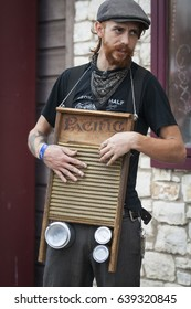 AUSTIN, TEXAS/USA - MARCH 2011: Street performer playing the washboard on Congress Avenue.