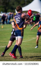 Austin, Texas/USA - October 19, 2014: The United States Australian Football League Championship in Austin, Texas. Fumbling for the ball.