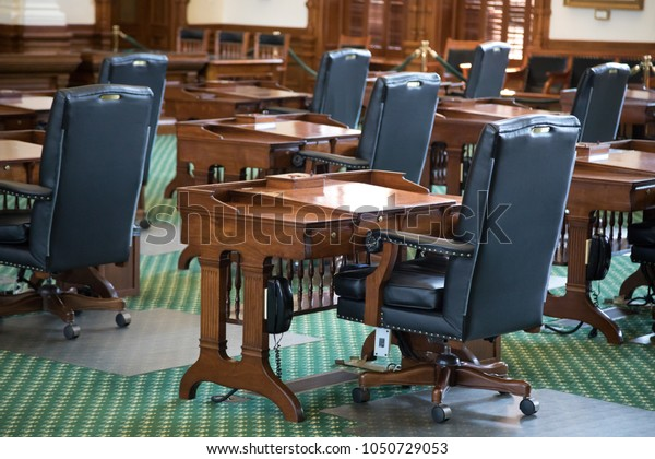 Austin, TEXAS/USA - September 9, 2017: Side view of wood desks and leather chairs in the Senate chambers, in the State Capitol building
