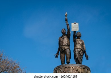 Austin, Texas/USA-January 21, 2020: Isolated view of Emancipation statue near the state capitol building set against brilliant blue sky.