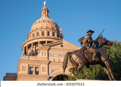 AUSTIN, TX - OCTOBER 28, 2017: Dome of the Texas capitol building in Austin, Texas with Texas Rangers monument statue in foreground.