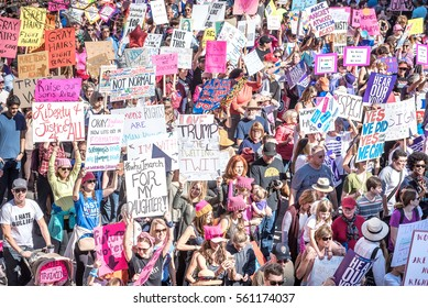 Austin, Tx, USA - 21 September 2017. EDITORIAL - Demonstrators carry signs in downtown Austin during the Women's March to protest Donald Trumps tone towards women and minority groups.