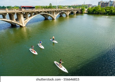 Austin, TX USA - April 14, 2016: Paddle boarders cruising along the Colorado River by the Lamar Street Bridge in the downtown area.