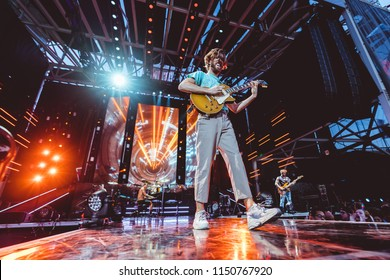AUSTIN, TX / USA - August 2nd, 2018: Wayne Sermon of Imagine Dragons performs onstage at Austin360 Amphitheater.