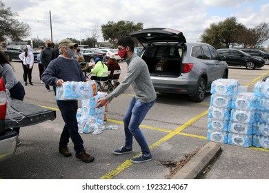 Austin, TX USA - Feb. 21, 2021:  Volunteers organize emergency water aid being distributed by the City of Austin at a drive through event to people in need due to outages caused by a winter storm.