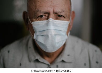 Austin, TX / USA - March 12th, 2020: Senior attending to self care using diabetes tools, taking pills, checking temperature and using face mask
