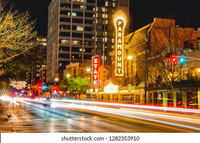 Austin, TX--Jan 09, 2019; time exposure of traffic lights on congress avenue in downtown Austin infront of the Paramount and State theaters at night