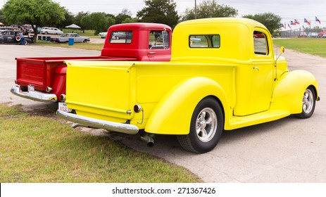 AUSTIN, TX/USA - April 17, 2015: Two pickup trucks at the Lonestar Round Up, a celebration of 1963-and-earlier American hot rods and custom cars.