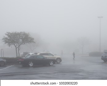 Austin, TX/USA - February 23 2018: Thick fog envelopes a parking lot