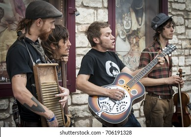 AUSTIN,TEXAS (USA) - MARCH 2011: Street folk band playing on Congress Avenue