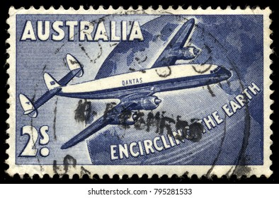 "AUSTRALIA - 1958: 2s blue postage stamp ""Encircling the Earth"" commemorating the first scheduled round the world air service by Qantas Airways using two Lockheed Super Constellation airliners"