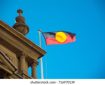 Australia aboriginal flag flying on Sydney Townhall building.