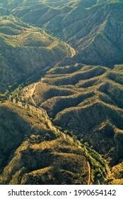 Australia, aerial view around Wilpena Pound with unsealed road through Bunyeroo Gorge, Flinders Range