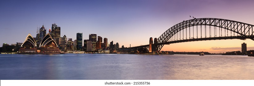 australia capital city Sydney view on CBD landmarks harbour, bridge and skyscrapers at sunset with hot-blue sky panoramic view