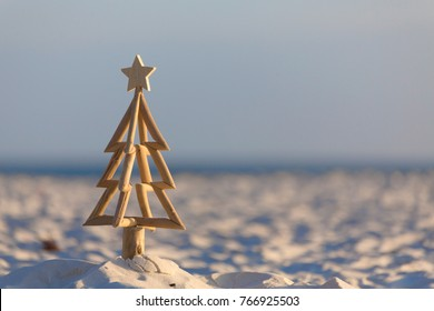 In Australia Christmas occurs in our summer months and lots of aussies celebrate Christmas outdoors or at the beach.  A driftwood Christmas tree stands in the sand of a beach in early morning light