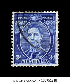 "AUSTRALIA - CIRCA 1937: A stamp printed in Australia shows portrait of King George VI, blue, from the series ""King George VI"", circa 1937"