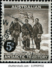AUSTRALIA - CIRCA 1959: A stamp printed in Australian antarctic territory shows Members of Shackleton Expedition at S. Magnetic Pole, 1909, circa 1959