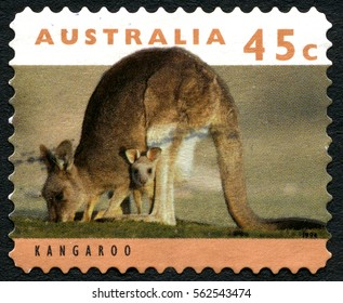 AUSTRALIA - CIRCA 1994: A used postage stamp from Australia, depicting an image of a Kangroo and Joey in its pouch, circa 1994.