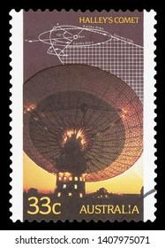 AUSTRALIA - CIRCA 2001: A Stamp printed in AUSTRALIA shows the Radio Telescope, Trajectory Diagram of Comet Halley, circa 2001