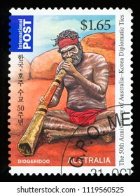 AUSTRALIA - CIRCA 2011:A Cancelled postage stamp from Australia illustrating Aboriginal playing on didgeridoo, issued in 2011.