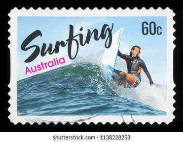 AUSTRALIA - CIRCA 2013: A stamp printed in Australia shows women surfing, circa 2013