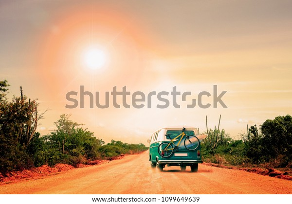 Australia, Coral Bay, May 16, 2018. Traveling camper with bike and surfboard in Australia.  Holiday trip in motorhome, Caravan car Vacation