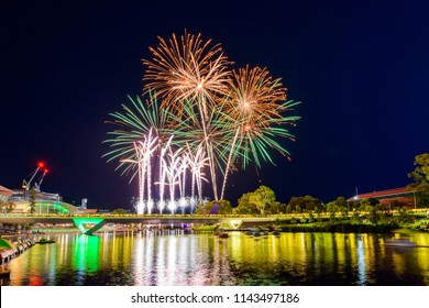 Australia Day fireworks in Elder Park, Adelaide city viewed across Torrens foot bridge