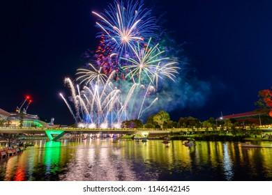 Australia Day fireworks in Elder Park, Adelaide city viewed accross Torrens foot bridge