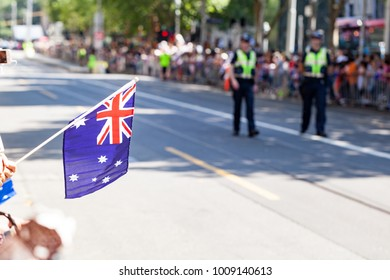 Australia day parade flag with police in the background