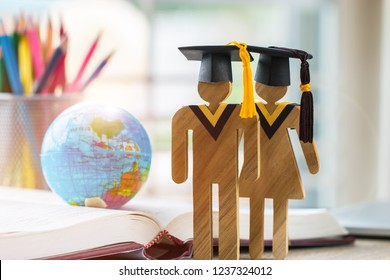 Australia Education knowledge learning study abroad international Ideas. People Sign wood with Graduation celebrating cap on open textbook with model global map, alternative studying world wide