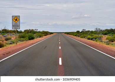 Australia, emergency airstrip aka roadstrip for Royal Flying Doctor Service on Stuart highway