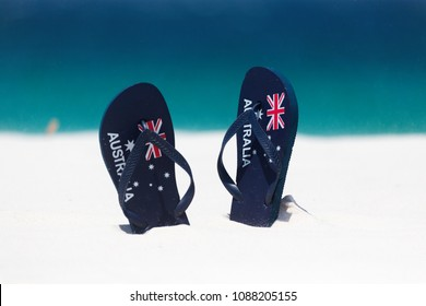 Australia Flag thongs in the sand by the beach in summer