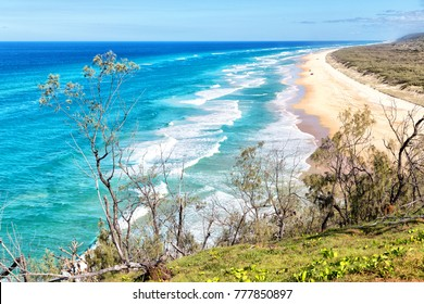 in  australia fraser island the beach near the rocks in the  wave of ocean