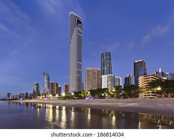 AUstralia Gold coast surfers paradise Q1 and other skyscrapers at the beach seashore sunrise illuminated lights view from the sea