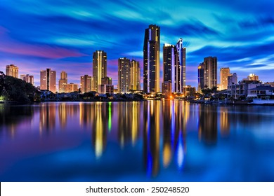 Australia Gold coast Surfers paradise city towers reflecting in still waters of river at sunset